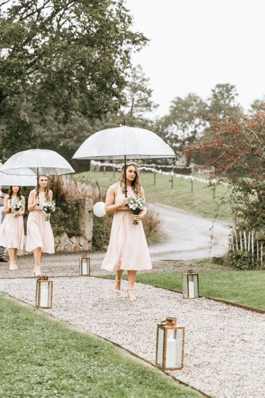 Bridal party arrive in pink dresses