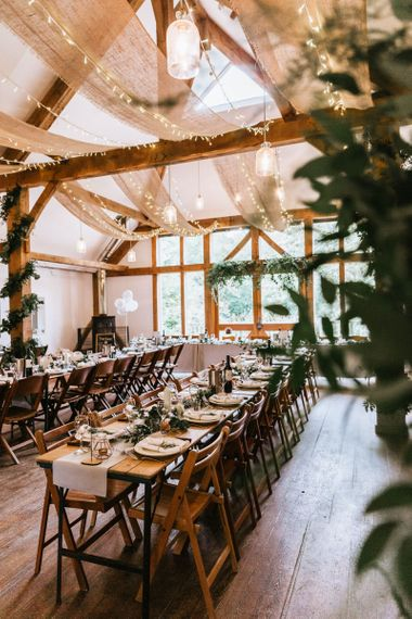 Nancarrow Farm wedding reception with fairy lights and foliage garlands
