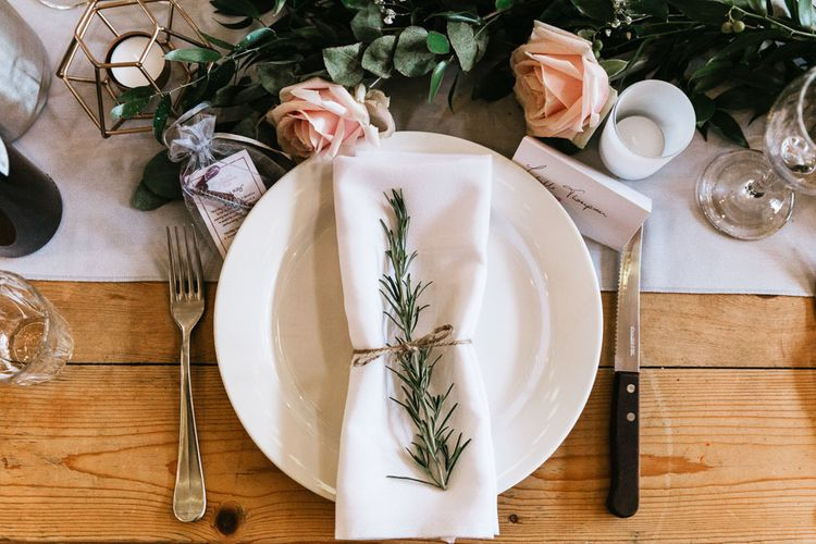 Wedding table place setting with floral decor