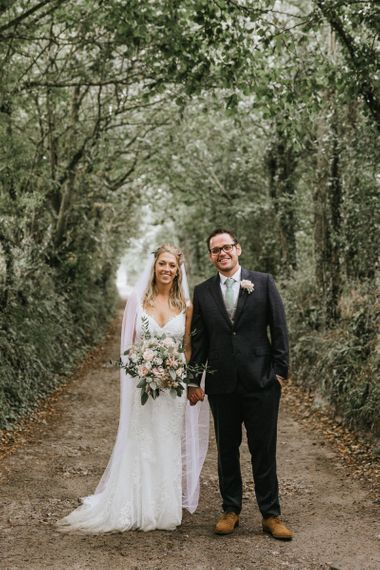 Bride and Groom at travel themed wedding