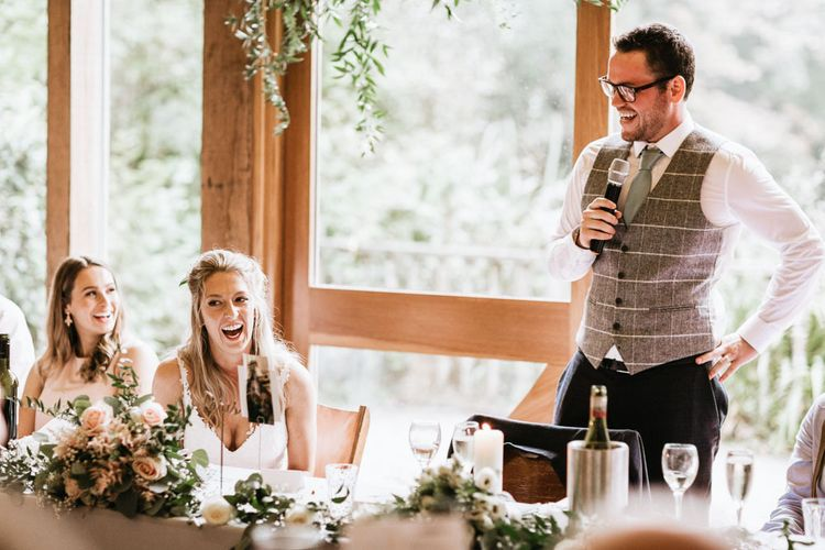 Bride enjoys grooms wedding speech