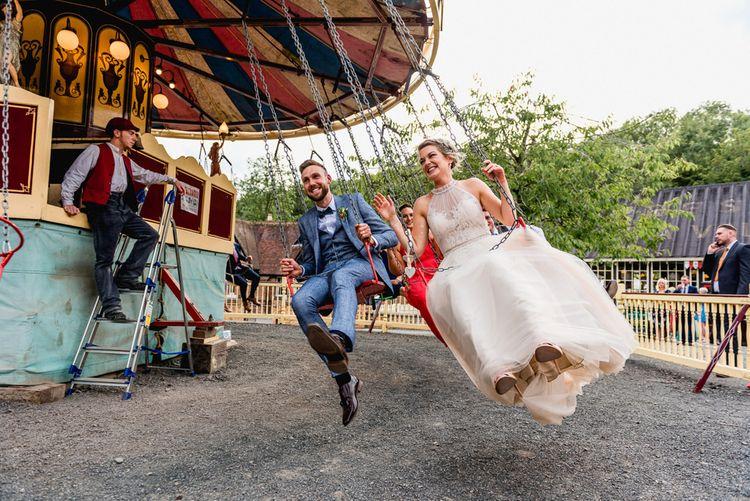 Fairground Swing Ride   Bride in Halterneck Tulle Allure Bridal Wedding Dress   Groom in  Blue Check Moss Bros. Suit   Vintage Fairground at Blists Hill Victorian Town Museum in Ironbridge   Lisa Carpenter Photographer