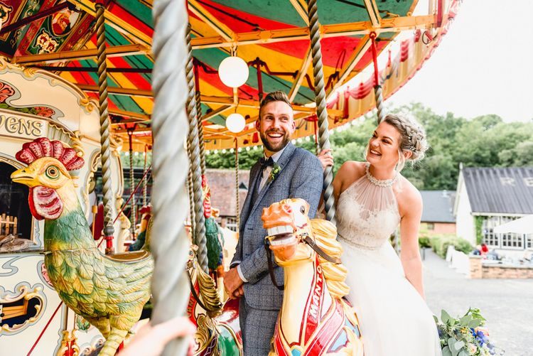 Carousel Ride   Bride in Halterneck Tulle Allure Bridal Wedding Dress   Groom in  Blue Check Moss Bros. Suit   Vintage Fairground at Blists Hill Victorian Town Museum in Ironbridge   Lisa Carpenter Photographer