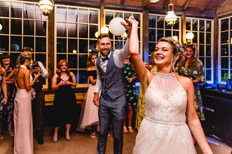 First Dance   Bride in Halterneck Tulle Allure Bridal Wedding Dress   Groom in  Blue Check Moss Bros. Suit   Vintage Fairground at Blists Hill Victorian Town Museum in Ironbridge   Lisa Carpenter Photographer