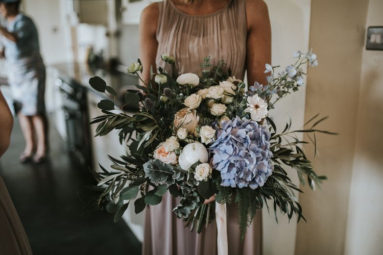 Bridesmaids Bouquet With Blue Hydrangea // Church Wedding In Norfolk // Woodland Luxe Wedding With Personalised Wooden Place Mats For Guests Marquee Wedding At Home With Images From Darina Stoda Photography