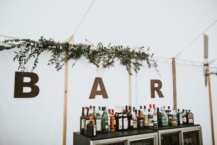 Wedding Bar // Woodland Luxe Wedding With Personalised Wooden Place Mats For Guests Marquee Wedding At Home With Images From Darina Stoda Photography