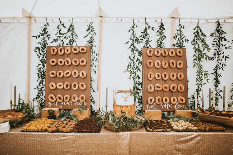 Donut Wall For Wedding // Woodland Luxe Wedding With Personalised Wooden Place Mats For Guests Marquee Wedding At Home With Images From Darina Stoda Photography