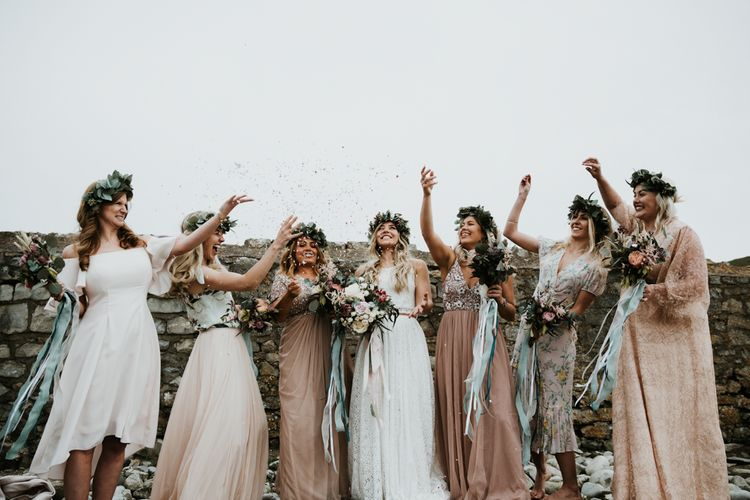 Bridesmaids In Mismatched Dresses For A Boho Beach Wedding // Second Hand Wedding Dress For An Eco Friendly Budget Wedding At Slade Farm In Wales With Images From Francesca Hill Photographer