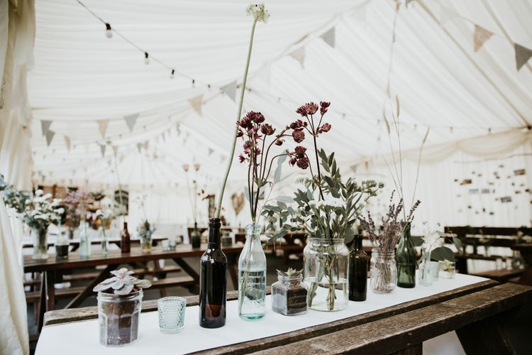 Budvase Flowers And Trestle Tables For Marquee Wedding // Eco Friendly Budget Wedding At Slade Farm In Wales With Images From Francesca Hill Photographer