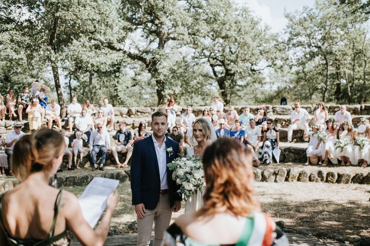 Outdoor Wedding Ceremony   Bride in Spell & the Gypsy Collective Bell Sleeve Wedding Dress   Groom in Chino's & Blazer   Outdoor Bohemian Destination Wedding at La Selva, Tuscany   Damien Milan Photography