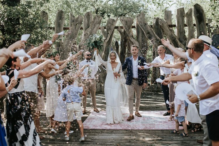 Confetti Moment   Bride in Spell & the Gypsy Collective Bell Sleeve Wedding Dress   Groom in Chino's & Blazer   Outdoor Bohemian Destination Wedding at La Selva, Tuscany   Damien Milan Photography