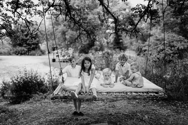 Children on a Swing   Outdoor Bohemian Destination Wedding at La Selva, Tuscany   Damien Milan Photography