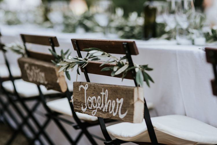 Wooden Together Chair Back Decor   Festoon Lit Outdoor Reception   Bohemian Destination Wedding at La Selva, Tuscany   Damien Milan Photography