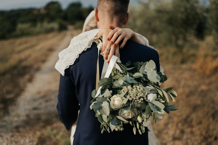 White & Green Bouquet   Bride in Spell & the Gypsy Collective Bell Sleeve Wedding Dress   Groom in Chino's & Blazer   Outdoor Bohemian Destination Wedding at La Selva, Tuscany   Damien Milan Photography