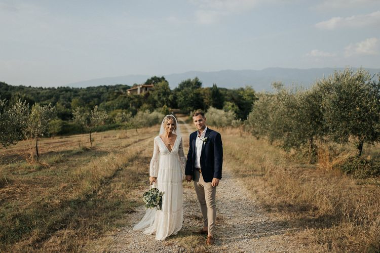 Bride in Spell & the Gypsy Collective Bell Sleeve Wedding Dress   Groom in Chino's & Blazer   Outdoor Bohemian Destination Wedding at La Selva, Tuscany   Damien Milan Photography