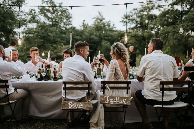 Wooden Chair Back Decor   Bride in Spell & the Gypsy Collective Bell Sleeve Wedding Dress   Groom in Chino's & Blazer   Outdoor Bohemian Destination Wedding at La Selva, Tuscany   Damien Milan Photography