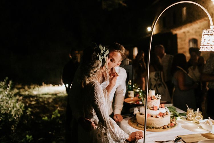 Cutting the Cake   Bride in Spell & the Gypsy Collective Bell Sleeve Wedding Dress   Groom in Chino's & Blazer   Outdoor Bohemian Destination Wedding at La Selva, Tuscany   Damien Milan Photography