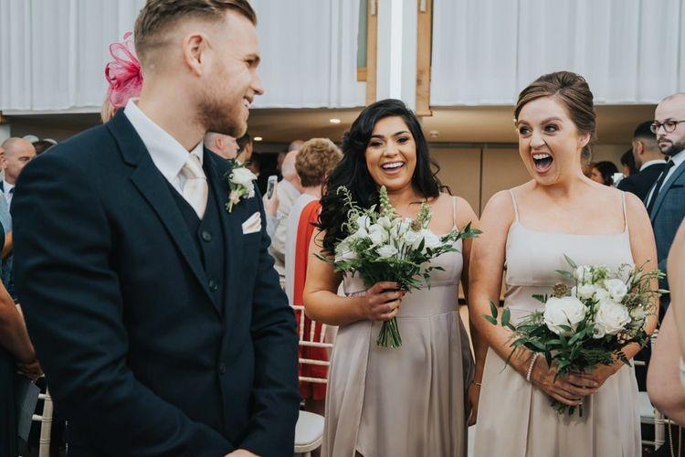 Bridesmaids walk down the aisle at civil  ceremony