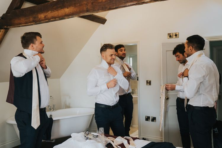 Groom and groomsmen getting ready for civil ceremony at Hornington Manor