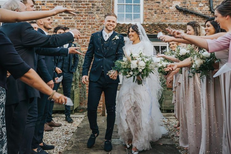 Confetti exit for bride and groom after civil ceremony