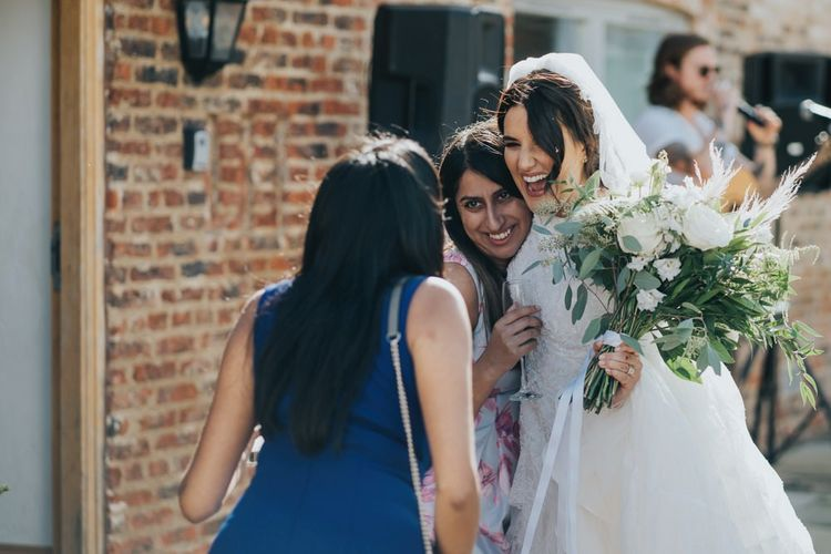 Bride mingles with guests after civil ceremony