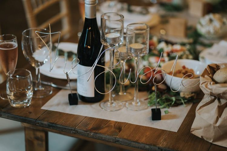 Sharing platters for guests at wedding breakfast with wire table names