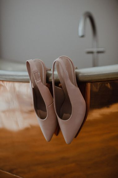 Nude slingback shoes with kitten heel for personal celebration with disco reception