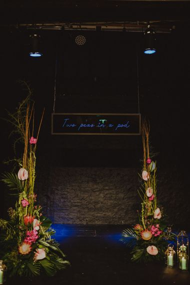Neon light sign at Sheffield wedding with botanical flowers and personal touches