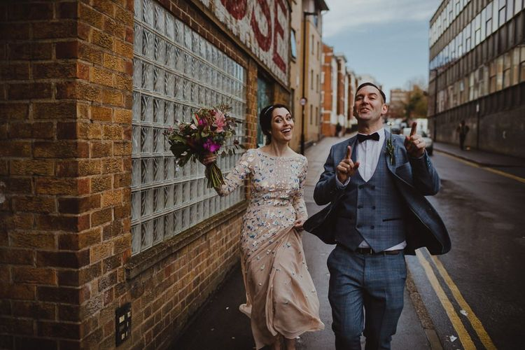 Bride and groom tie the knot at Sheffield wedding wearing embellished dress and three piece suit