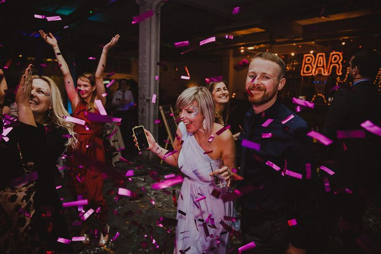 Guests enjoying disco rave reception with confetti
