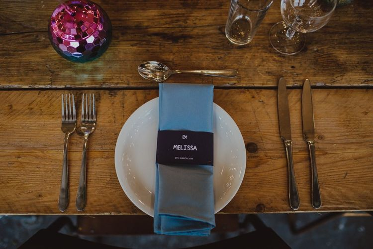 Disco balls and personalised table details at Sheffield wedding with industrial styling
