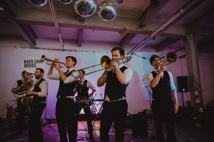 Brass band with disco ball decor at Sheffield wedding with disco rave reception
