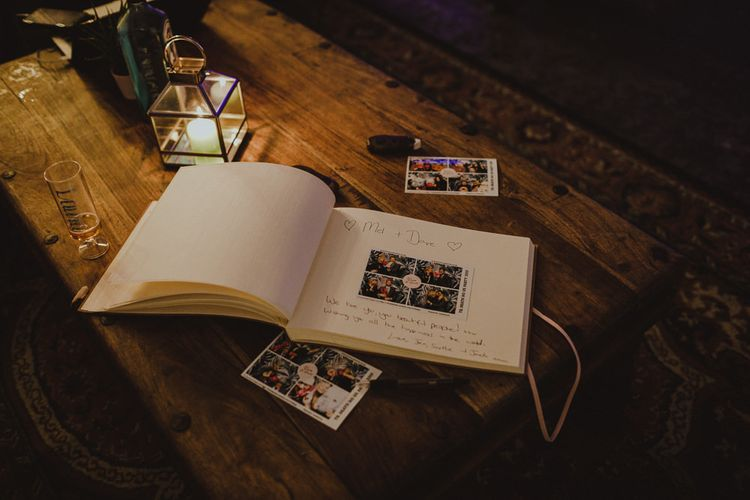 Photo Booth guestbook with candle lantern decor at industrial styled reception