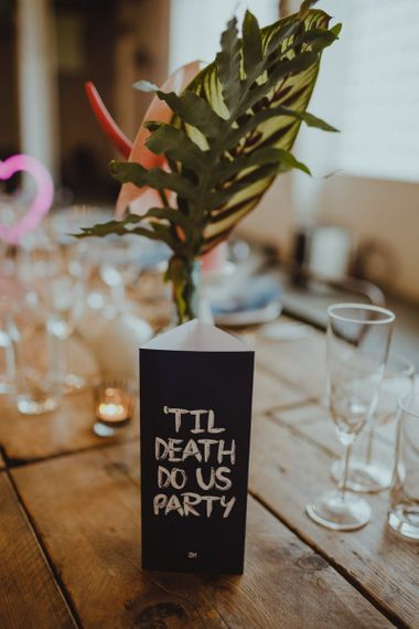 Tropical  table arrangement with 'til death do us party' sign and tea-lights for disco rave reception