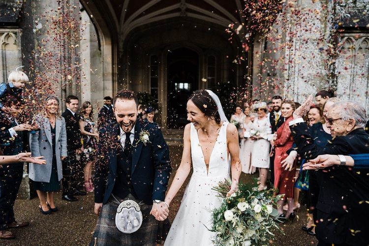 Confetti exit for bride and groom at Blairquhan Castle