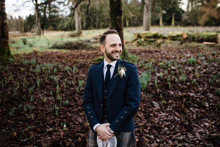 Groom in kilt at Scottish wedding in Blairquhan Castle