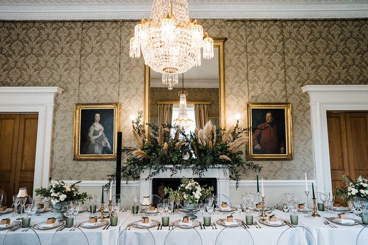 Wedding table decor with floral arrangements and pampas grass