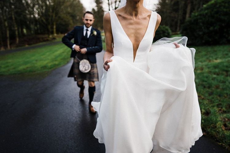 Suzanne Neville wedding dress with groom in traditional kilt