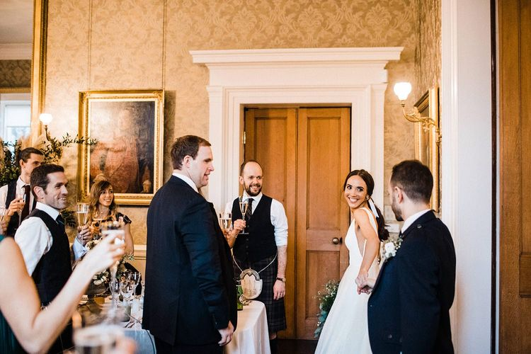 Bride and groom enter wedding breakfast at Blairquhan Castle