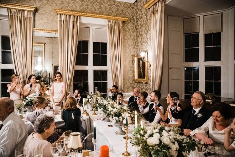 Guests toast the bride and groom during bridesmaid speeches