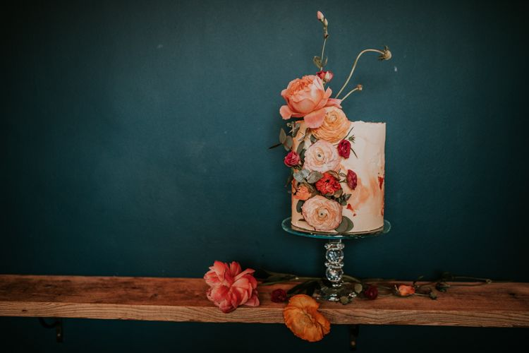 Tall Single Tier Wedding Cake Decorated with Coral Flowers