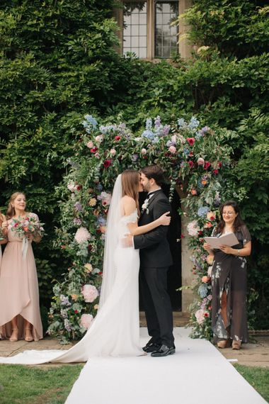 Outdoor Wedding Ceremony with Floral Arch | Bride in Lace Custom Made Pronovias Wedding Dress | Groom in Black Tie | Contemporary Elegance Wedding in the Countryside  | M & J Photography | Film by Jacob and Pauline