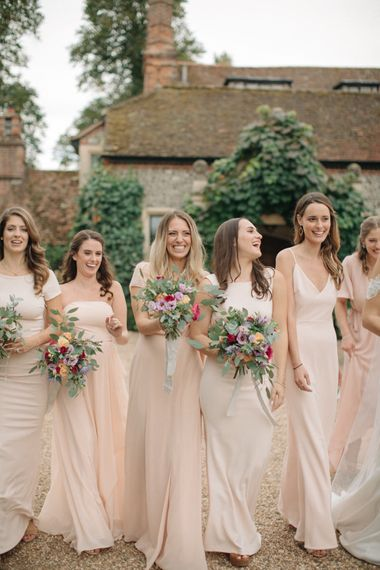 Bridesmaids in Peach Revolve Dresses | Contemporary Elegance Wedding in the Countryside  | M & J Photography | Film by Jacob and Pauline