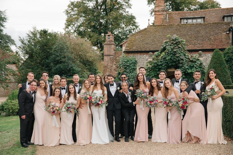 Wedding Party | Bride in Pronovias Wedding Dress | Bridesmaids in Peach Revolve Dresses | Groomsmen in Black Tie Suit | Contemporary Elegance Wedding in the Countryside  | M & J Photography | Film by Jacob and Pauline