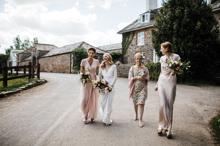 Bridal Party in Blush Pink Dresses Walking to the Wedding Ceremony