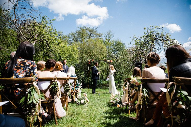 Bride and Groom Exchanging Vows at Outdoor Anran Wedding Ceremony