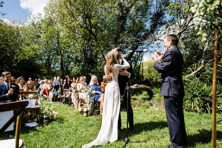 Bride and Groom Kiss at Outdoor Anran Wedding Ceremony