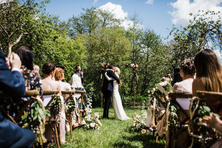Bride and Groom Embrace at Outdoor Anran Wedding Ceremony