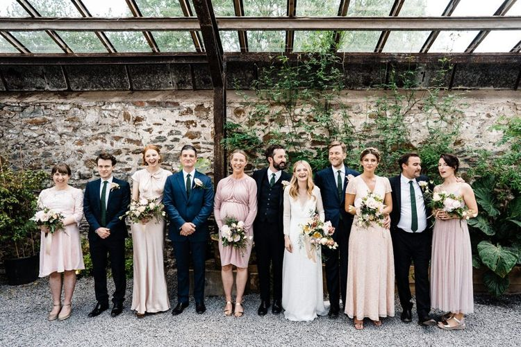 Wedding Party Portrait with Bridesmaids in Different Pink Dresses
