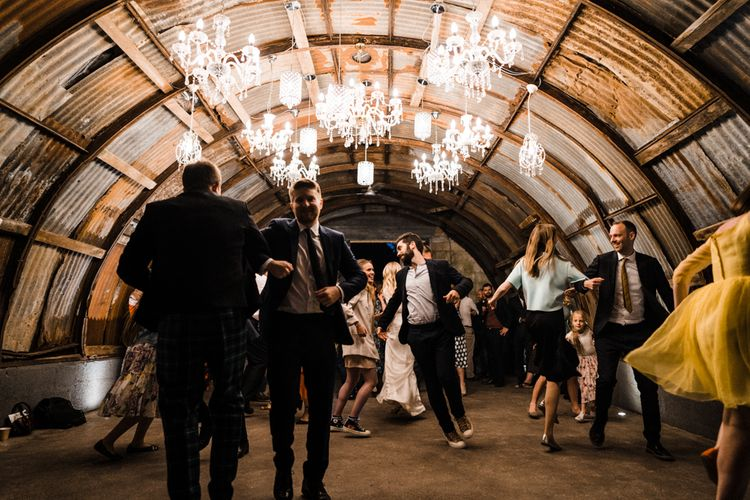 Chandelier Lit Cowshed Wedding Reception